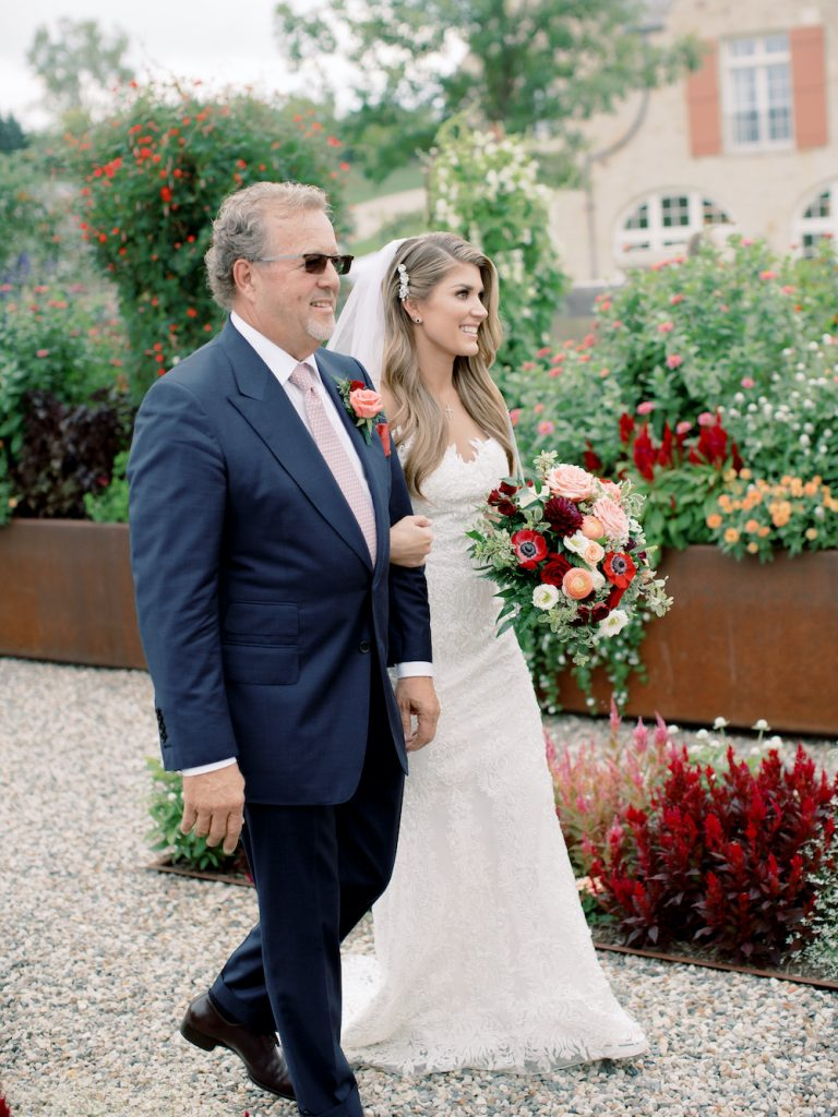 Walking down the aisle with dad - Intimate wedding at home in Ann Arbor, Michigan - Leah E. Moss Designs - Photo by Blaine Siesser