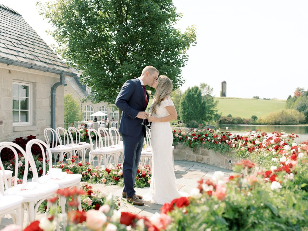 Bride and groom in small ceremony space - Intimate wedding at home in Ann Arbor, Michigan - Leah E. Moss Designs - Photo by Blaine Siesser