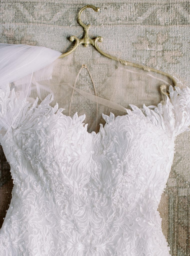 Lace dress on gold hanger - Intimate wedding at home in Ann Arbor, Michigan - Leah E. Moss Designs - Photo by Blaine Siesser