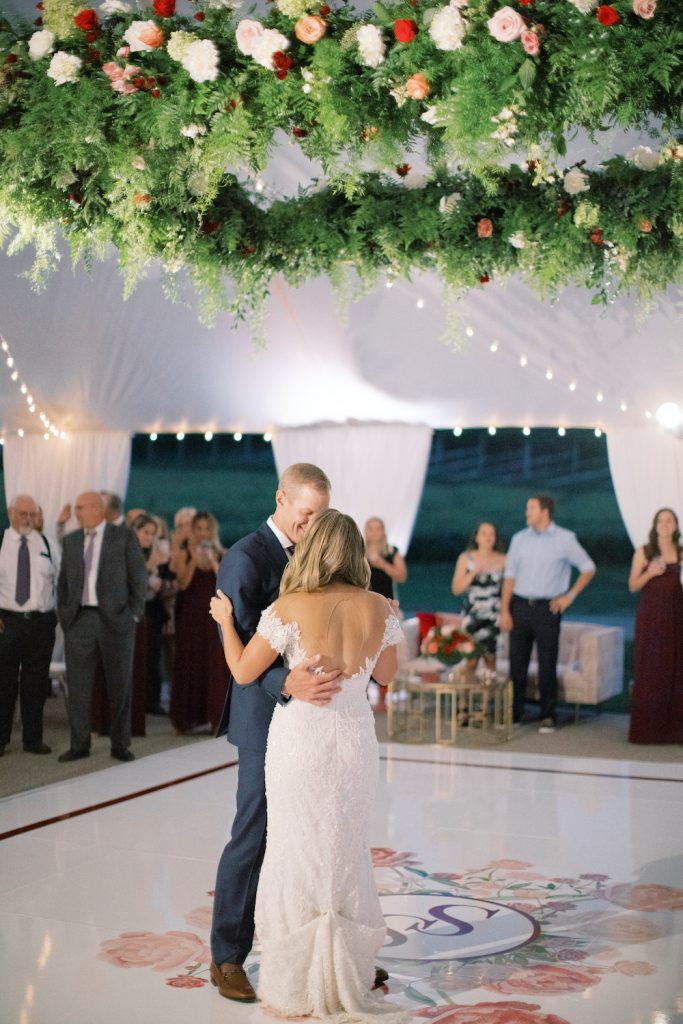 Couple's first dance, custom dance floor decal - Intimate wedding at home in Ann Arbor, Michigan - Leah E. Moss Designs - Photo by Blaine Siesser