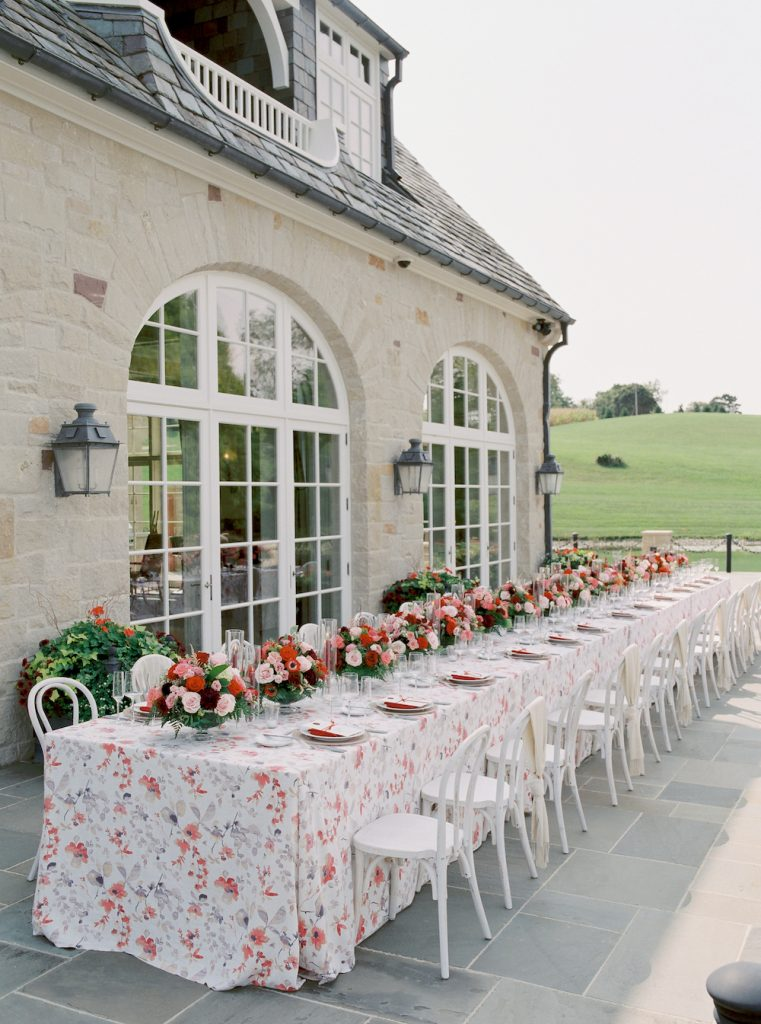One table for all guests with floral linen and luxury flowers - Intimate wedding at home in Ann Arbor, Michigan - Leah E. Moss Designs - Photo by Blaine Siesser