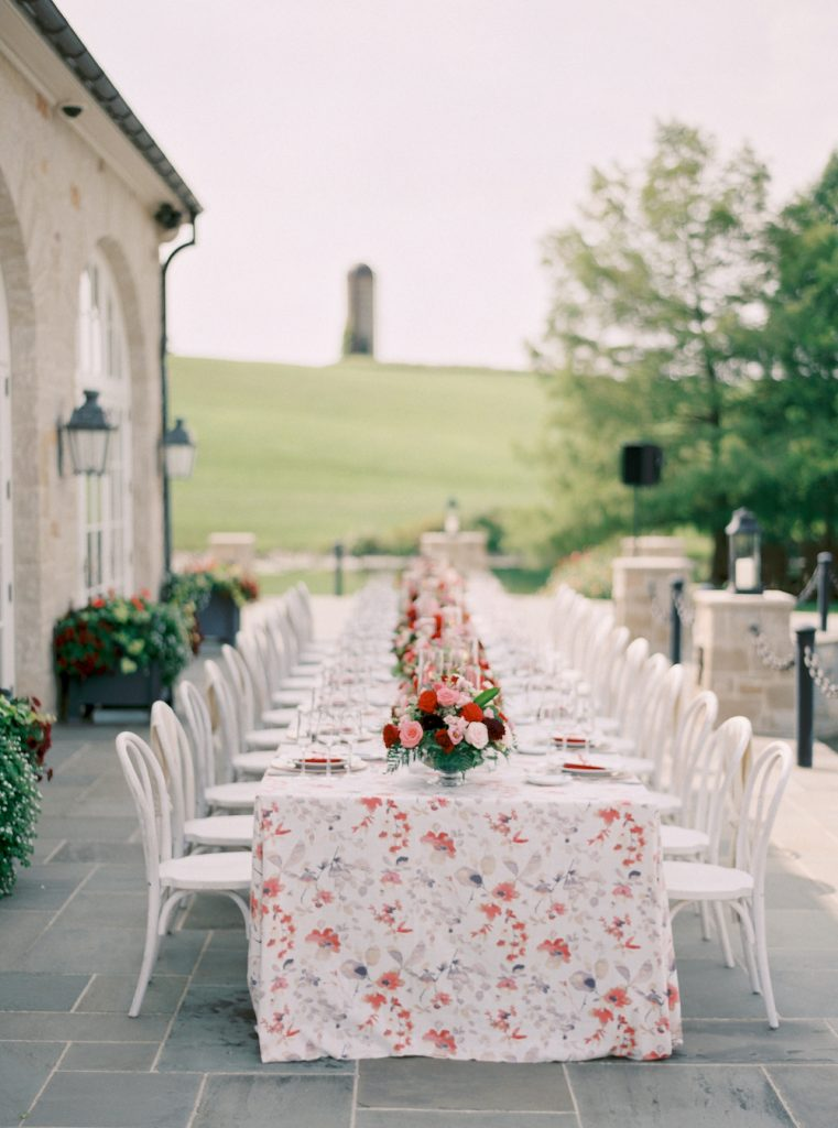 Luxury tablescape with florals and white chairs - Intimate wedding at home in Ann Arbor, Michigan - Leah E. Moss Designs - Photo by Blaine Siesser