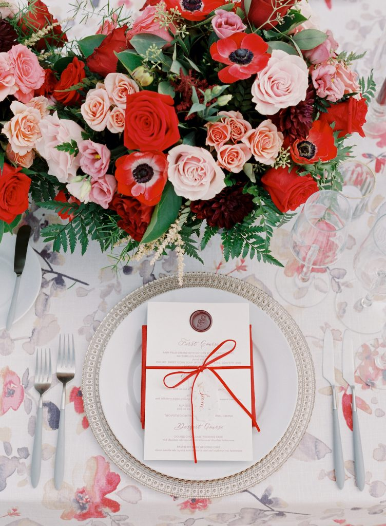 Red, pink, and burgundy florals with letterpress menu - Intimate wedding at home in Ann Arbor, Michigan - Leah E. Moss Designs - Photo by Blaine Siesser