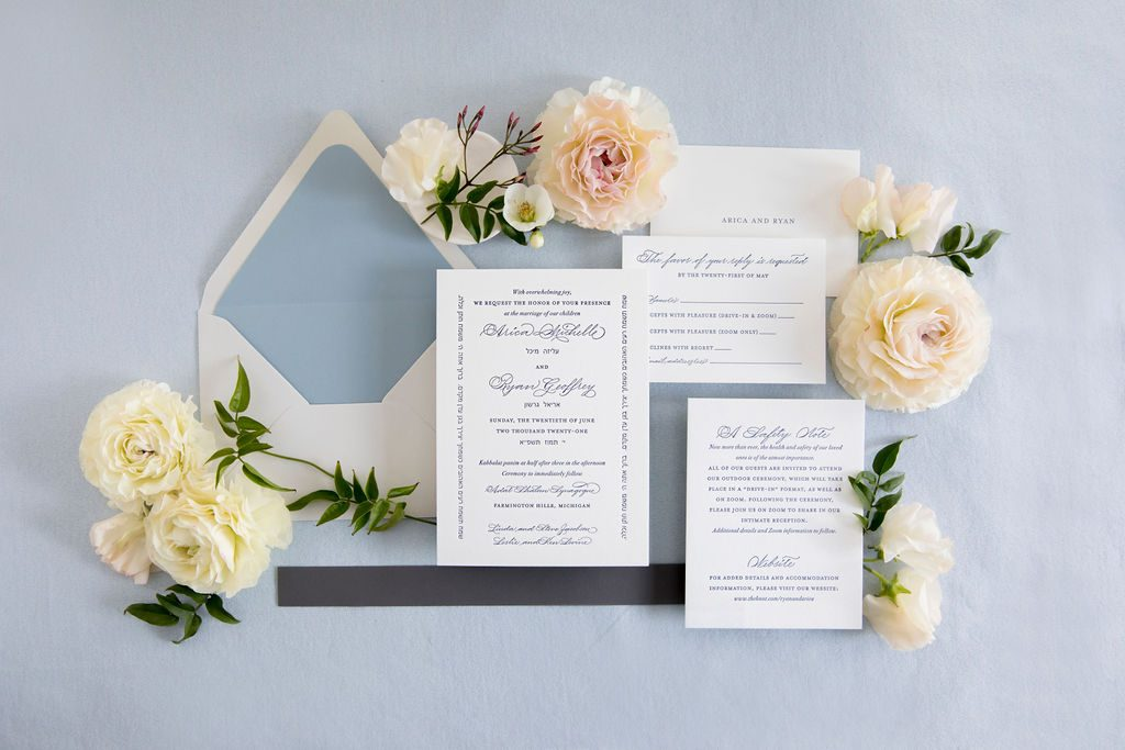 navy blue wedding invitation with traditional calligraphy flatlay - Leah E. Moss Designs