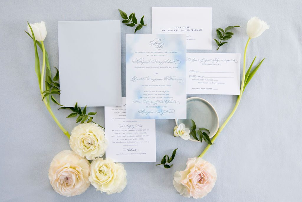 blue wedding invitation with abstract watercolor flatlay - Leah E. Moss Designs